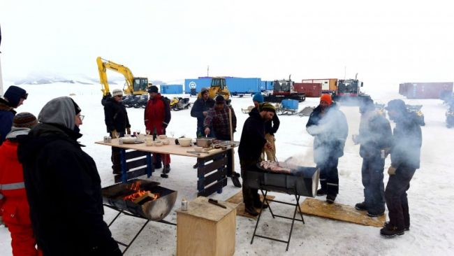 Scientists and crew at the Princess Elisabeth Antarctica enjoy a New Year's Eve barbecue - © Jos Van Hemelrijck