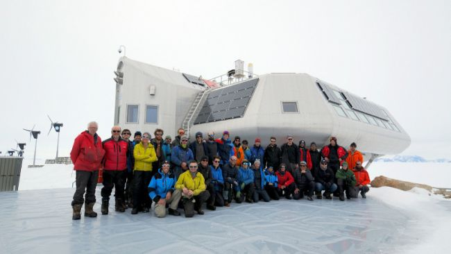 The 2019-2020 BELARE team poses for the annual group photo in front of the station - © International Polar Foundation