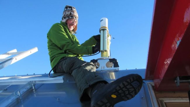 Alexander Mangold servicing his instruments on the roof - © International Polar Foundation / Alain Hubert