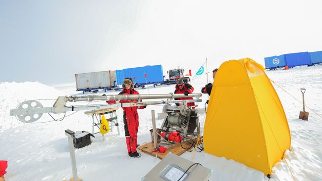 Checking out the drilling equipment used by the Icecon scientific team at the Field Camp. - © International Polar Foundation
