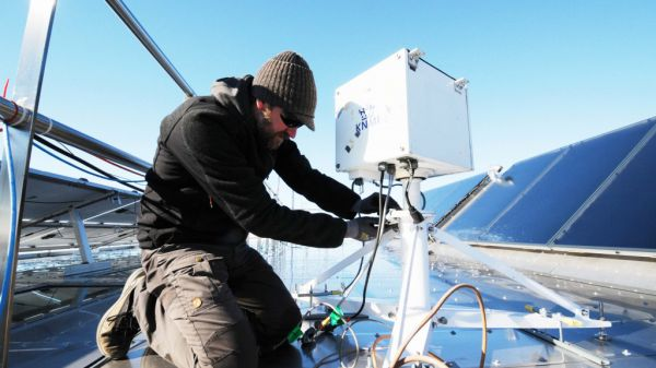 Many of the scientific instruments need to be removed from the roof of the station in order to keep them from being damaged by the rough winter conditions. Here Henri removes the Brewer Ozone-Sperctrophotometer from the Royal Meteorological Institute so it can be carefully stored until next season of data collection.  - © International Polar Foundation, Henri Robert