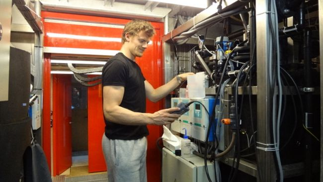 Jacob Bossaer at work on PEA's water treatment unit - © International Polar Foundation