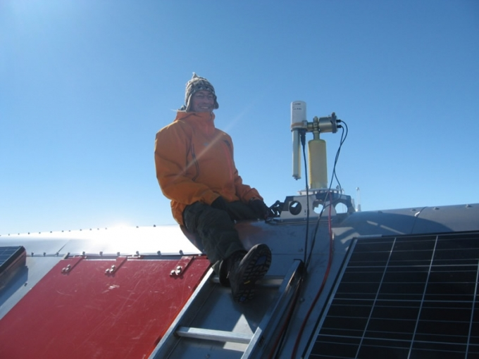 Dr. Alexander Mangold setting up an instrument on the roof of PEA - International Polar Foundation