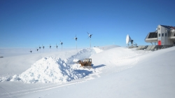 Clearing the accumulated snow in front of the garages - International Polar Foundation / Alain Hubert