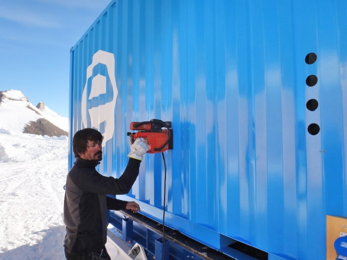 Illir working on the accommodation container. - International Polar Foundation