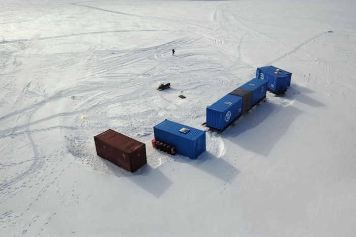 Aerial view of AWI's mobile base camp at the coast. - International Polar Foundation