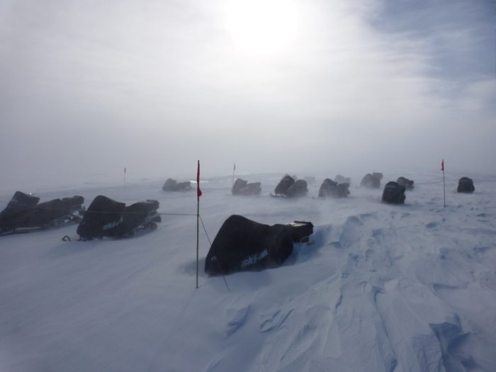 Skidoos at the field camp covered up against the intense blizzards of Antarctica. - International Polar Foundation/Alain Hubert