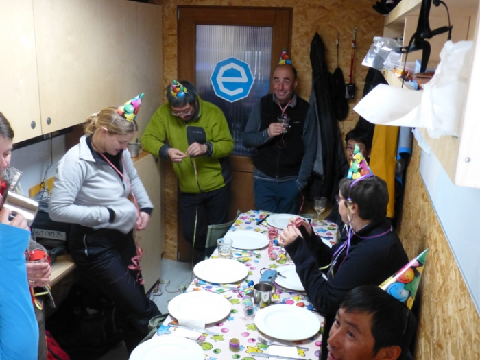 Happy New Year! SAMBA and Princess Elisabeth Antarctica team celebrating 2013 in the cosy confines of the field camp container. - International Polar Foundation/Alain Hubert