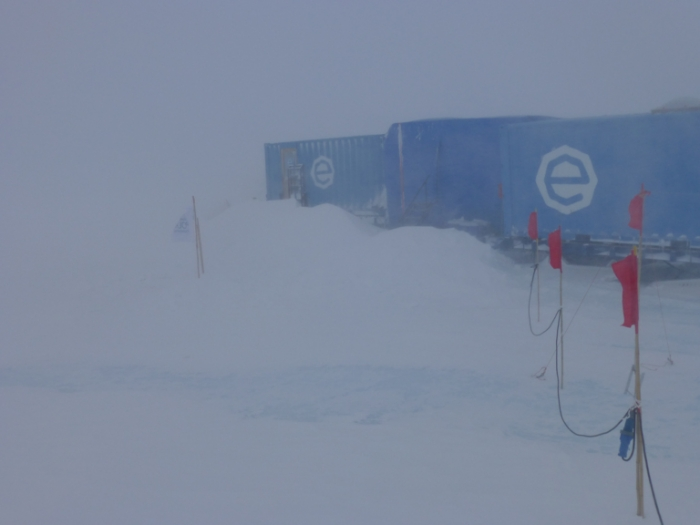 Wild weather whips around the field camp on the Antarctic plateau, beset by severe weather. - International Polar Foundation/Alain Hubert
