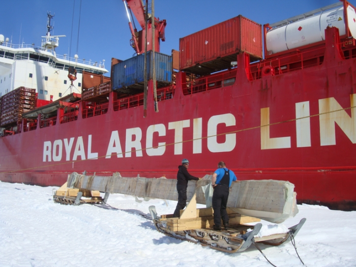Unloading beams from the Mary Arctica at the Antarctic Coast, before transportation to Princess Elisabeth Antarctica, for use in constructing a new entrance hall.  - International Polar Foundation/Alain Hubert